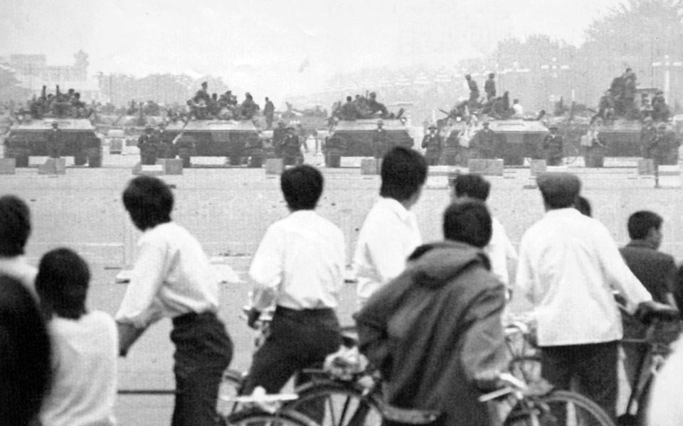 Crowds of curious Beijing residents gather to look at the military hardware in Tiananmen Square, June 7, 1989. AP PHOTO