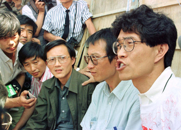 Hou Dejian (right), a Taiwanese singer who defected to China in 1983, and his fellow hunger strikers talk to journalists. Reuters
