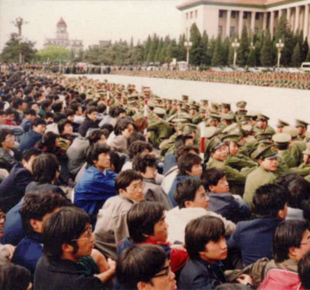 Students sitting outside the Great Hall of the People on April 21, 1989 following Hu Yaobang's death
