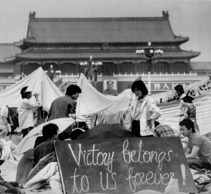 Students gather in Tiananmen Square, May 28, 1989 behind a sign that reads Victory belongs to us forever! REUTERS